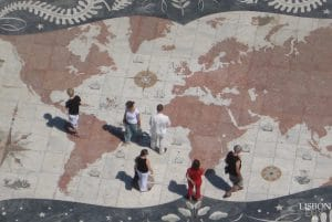 people observing world map at discoveries monument in Lisbon