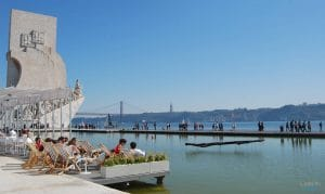 people enjoying sun at discoveries monument in Lisbon