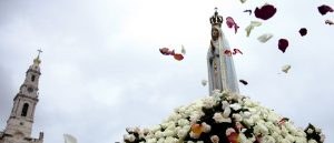 figure of Virgin Mary with petals at sanctuary of Fatima Portugal