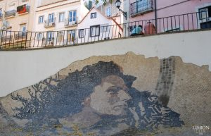 street art made with cobblestones by vhils in alfama Lisbon