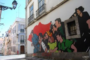 street art on a narrow street in Lisbon