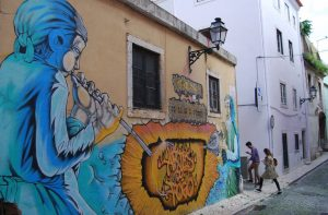 street art on a narrow street in Lisbon