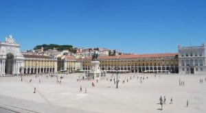 people walking by the commerce square in Lisbon Portugal