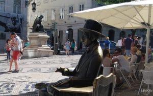 statue of famous poet Fernando pessoa in chiado Lisbon