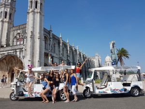 Group of girls in front of tuk tuks at Mosteiro dos Jerónimos in Belem, Lisbon