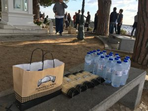 Pack of custard tarts and bottles of water on a street bench