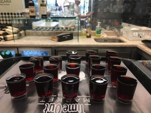 glasses of Portuguese liquor ginjinha in the Time Out Market Lisbon
