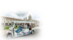 woman guide giving explanations on a tuk tuk in Belem Portugal