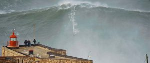 Man surfing on a giant wave in Nazaré Portugal