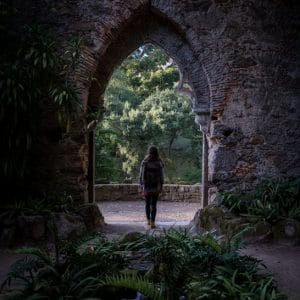 girl looking at stone arc in Sintra Portugal