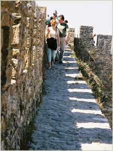 group of people on top of the medieval wall in Obidos