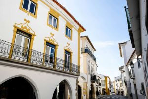 Details of a typical white and yellow house in Evora Portugal