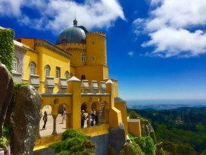 yellow facade of the pena palace in sintra Portugal