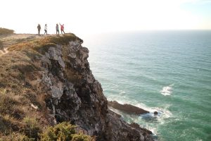 group of people near a cliff in the Portuguese coast