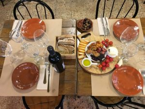 table with red wine and tapas for a food tour