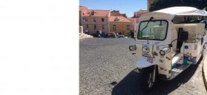 close up of a white and decorated tuk tuk in Lisbon