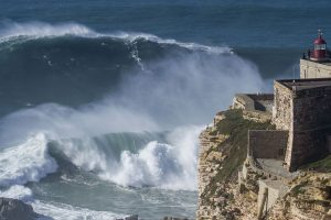 view of the goat waves at the lighthouse in Nazare Portugal