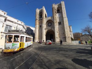tram 28 passing in front of the cathedral in Lisbon